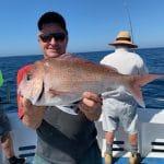 Man holding fresh caught Reef Fish on Summer 2018-2019f