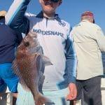 Man holding Reef Fish on Summer 2018-2019