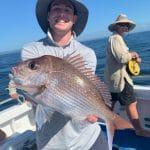 Man showing fresh caught Huge Fish on Summer 2018-2019