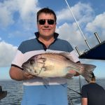 Man showing a Freshly Caught Snapper in Autumn 2019