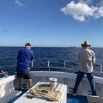 Men Having fun doing Deep Sea Fishing