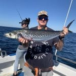Old Man showing a Big Mackerel Fish in Autumn 2019