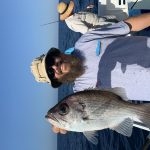 Man Holding a Big Fish on Fishing Charter in Auntumn 2019