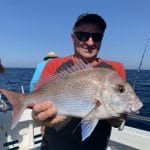 Old Man showing Big Snapper Fish in Autumn 2019