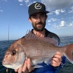 Young Man Showing a Huge Snapper on Fishing Charter