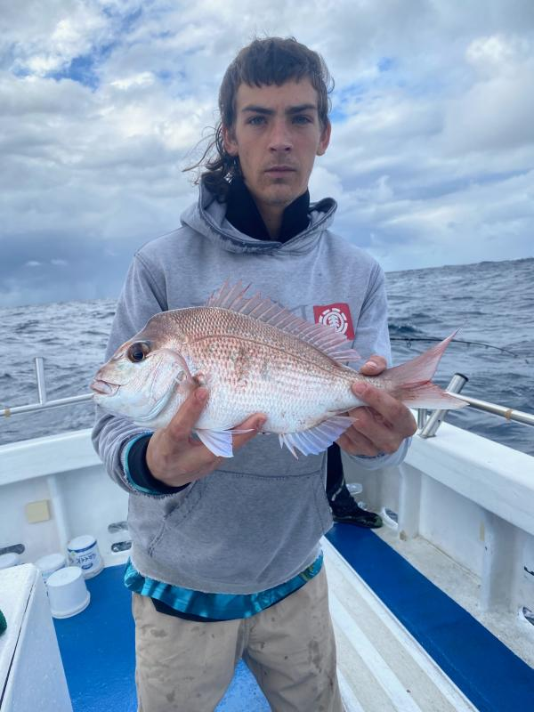 Young Man caught a Snapper Fish in Autumn-Winter 2020