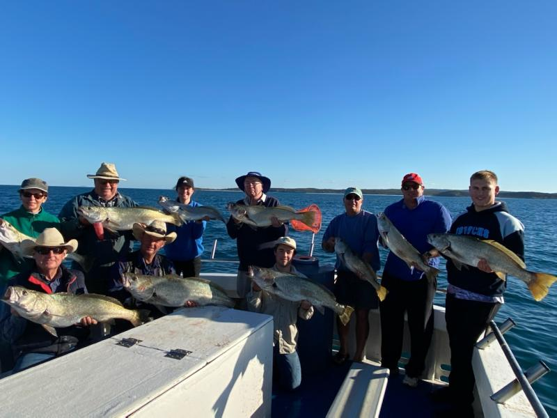 Tourists Holding Big Fishes in Autumn-Winter 2020