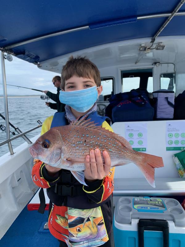 In Autumn-Winter 2020 Kid showing Fresh caught fish