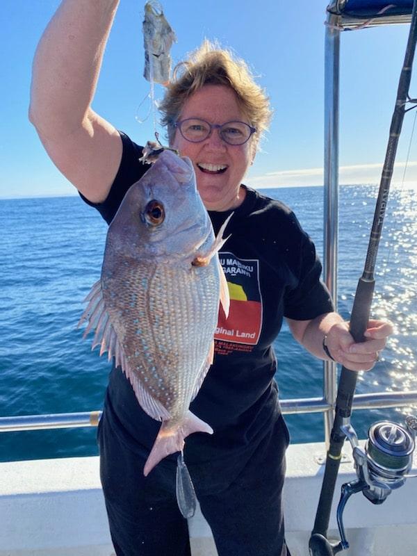 A fish caught by Woman in Autumn-Winter 2020