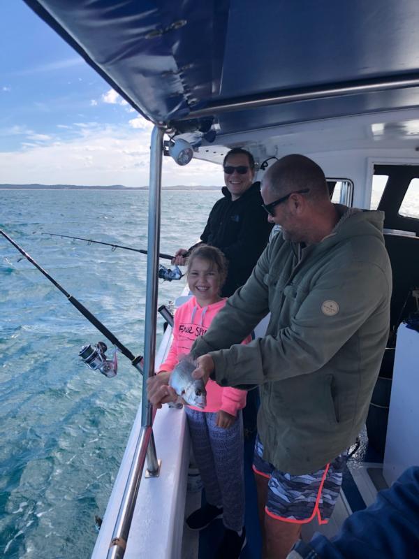Little Girl Enjoying Deep Sea Fishing With Her Dad